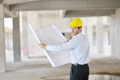 Architect on construction site Royalty Free Stock Image