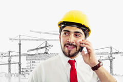 Architect at construction site. With cellphone copyspace Stock Photo