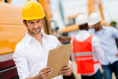 Architect at a construction site Royalty Free Stock Photo