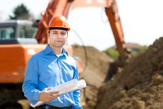 Architect in a construction site Royalty Free Stock Images