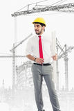 Architect at construction site. With plans Stock Image