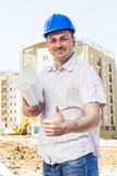 Architect at construction site Stock Photo