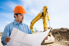 Architect in a construction site. Portrait of an architect at work in a construction site Stock Images