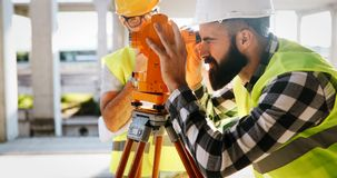 Architect consult engineer on construction site. Architect consult engineer on construction or building site Royalty Free Stock Image