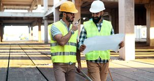 Architect consult engineer on construction site. Architect consult engineer on construction or building site Royalty Free Stock Photo
