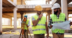Architect consult engineer on construction site. Architect consult engineer on construction or building site Royalty Free Stock Images