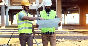 Architect consult engineer on construction site. Architect consult engineer on construction or building site stock image