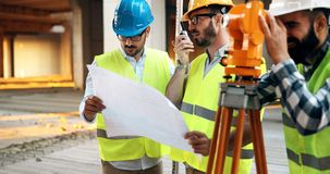 Architect consult engineer on construction site. Architect consult engineer on construction or building site Stock Photography