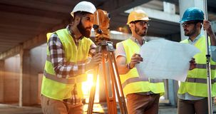 Architect consult engineer on modern construction site royalty free stock photos