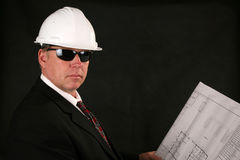 Architect or contractor. Reading blueprints and construction plans Stock Image