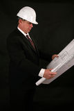 Architect or contractor. Reading blueprints and construction plans Royalty Free Stock Photo