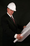 Architect or contractor. Reading blueprints and construction plans Stock Photo