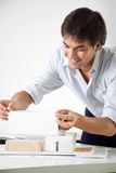 Architect Creating a Model House Stock Image