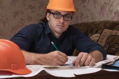 The architect at the customer is drawing a plan for the redevelopment of the apartment.  Stock Image