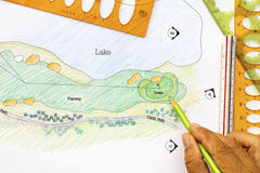 Architect design golf course plan. Royalty Free Stock Photo