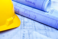 Architect design printout and safety helmet Stock Image