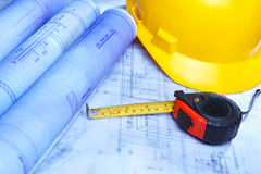 Architect design printout and safety helmet Royalty Free Stock Images