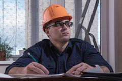Architect or designer in the process of work. Working man royalty free stock photo