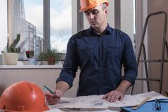 Architect or designer in the process of work. Working man stock photo
