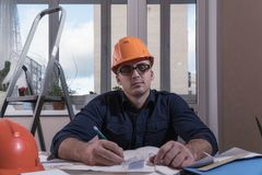 Architect or designer in the process of work. Working man royalty free stock images