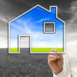 Architect designing an eco friendly house Stock Photos