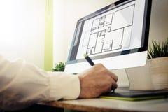 Architect designing a house Royalty Free Stock Image