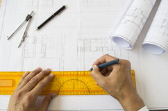 Architect designing a plane Royalty Free Stock Photo