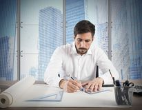 Architect designs. Man architect designs a new residential project Stock Image