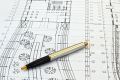 Architect desk with pen and construction drafts Stock Images