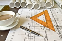 Architect desk with rolls and plans Royalty Free Stock Image