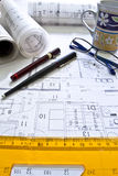 Architect desk with rolls and plans Stock Images