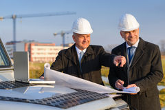Architect developer point at construction site Stock Photos