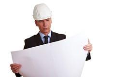 Architect die bouw bekijkt stock afbeeldingen