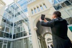 Architect die hun werk fotograferen Succesvolle zakenman in FO Royalty-vrije Stock Foto