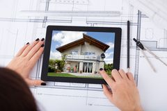 Architect with digital tablet and blueprint Royalty Free Stock Photography