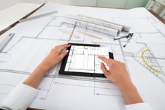 Architect with digital tablet over blueprint Royalty Free Stock Images