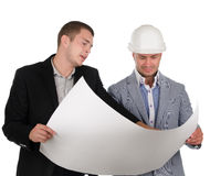 Architect discussing a blueprint with his partner Stock Photo
