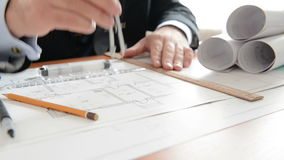 Architect does measuring on a draft. Full HD Stock Images