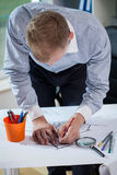 Architect drafing the building Royalty Free Stock Photo