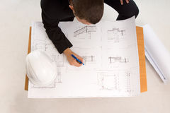 Architect drafting a building plan royalty free stock image