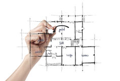 Architect drafting a house. An architect puts the sketch design touches on the blueprint for a new house Royalty Free Stock Image