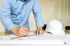 Architect drawing architectural project on blueprint, engineerin Royalty Free Stock Photos