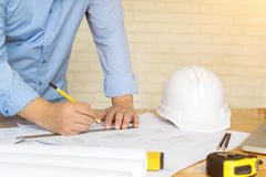 Architect drawing architectural project on blueprint, engineerin Stock Photo