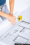 Architect drawing on blueprint Stock Photos