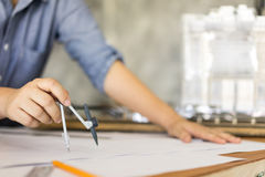 Architect drawing on blueprint architectural concep Stock Photos