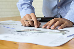 Architect drawing on blueprint Royalty Free Stock Photography