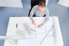 Architect drawing on blueprint Stock Photo