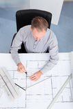 Architect Drawing On Blueprint Royalty Free Stock Photos