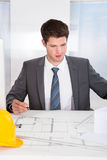 Architect Drawing On Blueprint Royalty Free Stock Photo