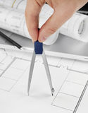 Architect with drawing compass Stock Photo